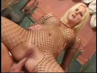 Blonde minx from Slovakia was taking bath in fishnet bodystockings when muscular fucked joined her