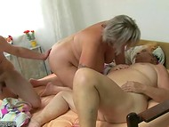 Lustful old woman eats some chocolate sweets and joins mature couple's sexual games 5