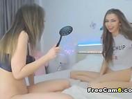 Shameless girl in black bra spanks her girlfriend's ass in front of web camera 6