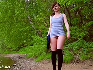 Kinky Jeny Smith is showing her shaved twat while walking through green park 7