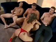 Astounding Polish MILF in red lingerie gives blowjob to three men, who are sitting on the couch