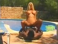 Big-boobied blonde from Norway gets fucked by black-skinned bloke by the poolside