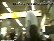 Badass with camera walks around the subway station and looks up girls' short skirts 7