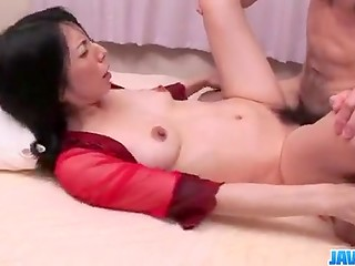 Man didn't want to be alone in the evening and he called Asian courtesan in red outfit