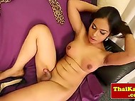 Transsexual from Thailand took off everything except leopard stockings and jerked off on camera