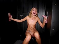 Red-haired MILF gladly satisfies two men in glory hole room at the same time