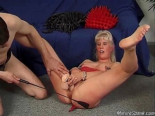 Mature woman plays the role of a dirty slave and caters to every whim of her dominator