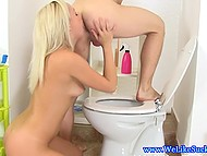Blonde-haired girl had just finished peeing when boyfriend entered the toilet and offered his cock for suck 7