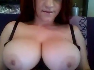 Young Arab girl demonstrates her huge hooters that fit hardly in brassiere on webcam