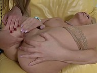 Blonde and girlfriend sat down on the yellow sofa and kneaded assholes with vibrating toys 10