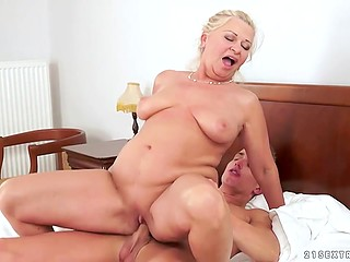 Mature dame is full of hot libido and prefers to seduce younger handsome boys