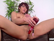 Mature lady shows on the camera the way she satisfies herself with a vibrator 5