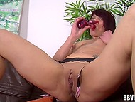 Mature lady shows on the camera the way she satisfies herself with a vibrator 7