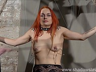 Red-haired prisoner in lace outfit was tied up and punished by perverted fatty girl in BDSM style 11