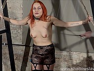 Red-haired prisoner in lace outfit was tied up and punished by perverted fatty girl in BDSM style 3