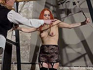 Red-haired prisoner in lace outfit was tied up and punished by perverted fatty girl in BDSM style 6