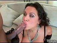 Lady with curvy shapes puts on black lingerie and gloves for familiarizing with black cock 6