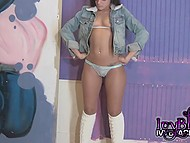 Tiny Ivy Black is fooling around in front of camera demonstrating her little titties and buttocks 11