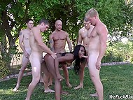 Some guys fuck young dark-skinned babe in turns near the pool and cum on her face 9