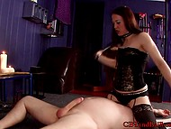 Dominatrix in sexy lingerie combines wrestling skills with pinpoint strikes on man's penis 4