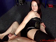 Dominatrix in sexy lingerie combines wrestling skills with pinpoint strikes on man's penis 7
