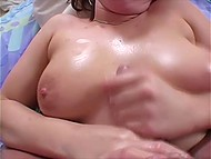 Female with big breasts has been handling cameraguy's penis for a long time till sperm covered her tits 7