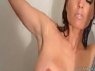 Excited MILF with big breasts stimulates her wet vagina under warm streams of water in shower 7