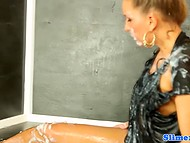 Rubber dick takes golden-haired girl by surprise blasting white jizz over her body from gloryhole 9