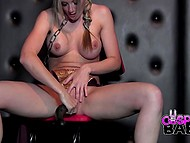 Buxom cosplay girl is chained to the chair in dungeon and she just keeps putting long dildo in her pussy 4
