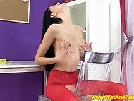 Black-haired babe in red stockings urinated lavishly and spattered cameraman's pants 4