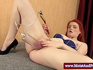 Red-haired madame masturbates her pussy helping herself with favorite vibrator 4