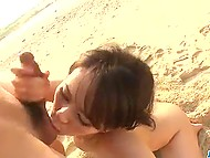 Busty Asian's moans mingled with the sound of waves while she was getting fucked on the beach 4
