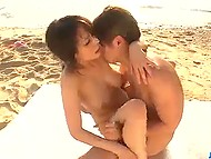 Busty Asian's moans mingled with the sound of waves while she was getting fucked on the beach 6
