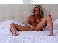After taking off the dress and lying on the bed, fabulous Brandi Love started to finger vagina 10