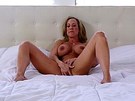 After taking off the dress and lying on the bed, fabulous Brandi Love started to finger vagina 5
