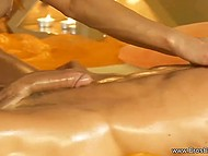Naked masseuse oiled and teased erect boner of pleased client in relaxing ambiance 7