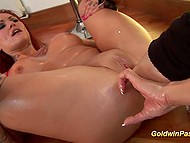 Scene of mad fisting performed by skilled lesbian to red-headed whore with huge tits 9