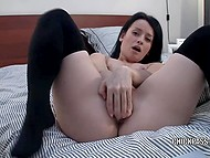 Brunette girl spreads her legs in stockings in front of webcam to finger excited pussy 11
