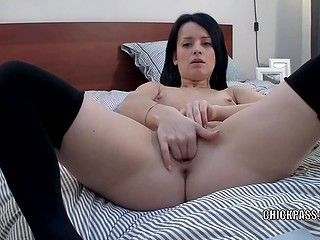 Brunette girl spreads her legs in stockings in front of webcam to finger excited pussy
