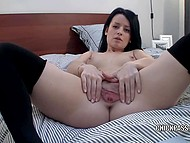 Brunette girl spreads her legs in stockings in front of webcam to finger excited pussy 8
