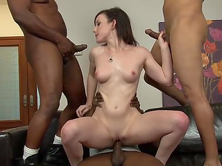 Scene of hardcore interracial banging featuring skinny bitch and three black fuckers