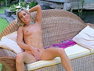 Beautiful weather provokes slender MILF to make herself comfortable on wicker sofa and tickle pierced pussy 8