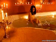 Pampered Indian lady takes care of her slender body: covers it with rose petals and splashes in warm bath 8