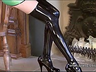 Long-legged model puts on latex suit to emphasize her perfect shapes for erotic photo session 6