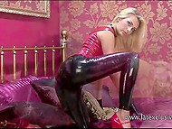 Latex outfit emphasizes sexy beauties of slender blonde model on bed 6