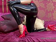 Latex outfit emphasizes sexy beauties of slender blonde model on bed 8