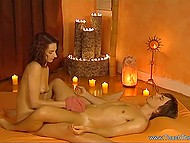 Masseuse with curly hair gently oiled visitor's body and gave him relaxing handjob 8