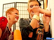 Two glamour women handle long dildo from gloryhole that has infinite stock of white liquid 8
