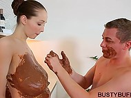 Sweet-tooth covered housewife's massive breasts with chocolate and moved cock between them 4