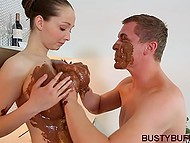 Sweet-tooth covered housewife's massive breasts with chocolate and moved cock between them 6